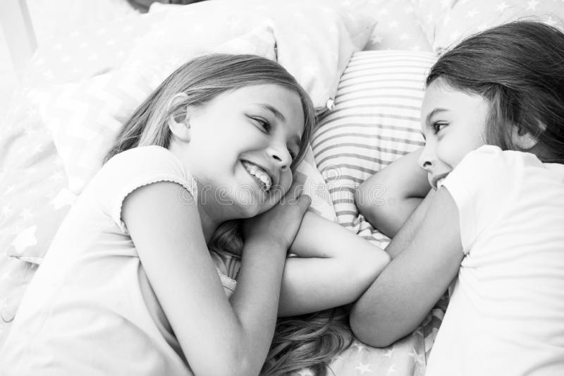 Best friends forever. Girls relaxing on bed. Slumber party concept. Girls just want to have fun. Invite friend for. Sleepover. Consider theme slumber party royalty free stock photos