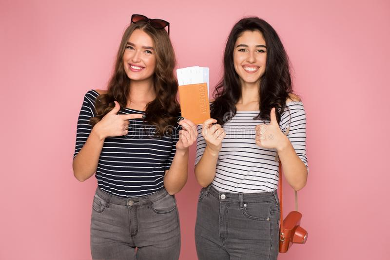 Best friends goint to trip, holding tickets and passport royalty free stock photography