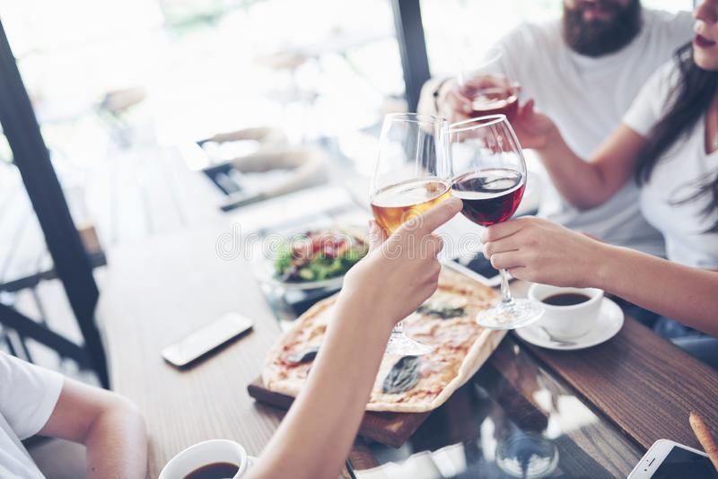 Friends got together by table with delicious food with glasses of red wine to celebrate a special occasion stock photography