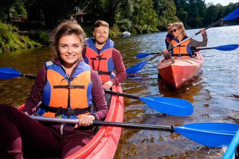 Best friends having fun on a kayaks stock photography