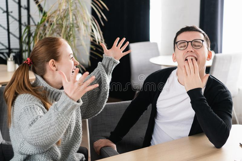 Best friends having a lunch coffee break after work, speaking and laughing about funny moments. Woman emotionally speaks royalty free stock photo