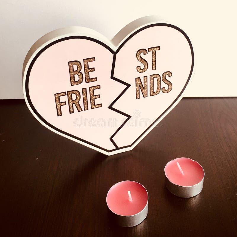 Best friends heart shape cutout with tea lights. Best friends heart cutout with tea lights stock images