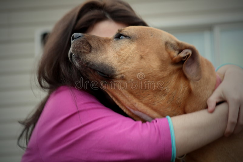 Best friends hug. Girl and dog giving her a puppy hug love