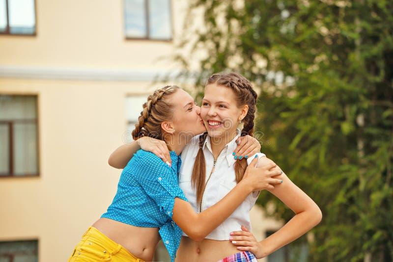 Poljubite osobu iznad - Page 3 Best-friends-kiss-cheek-park-teenagers-met-summer-girls-dressed-shorts-shirt-girl-kissing-her-friend-57136981