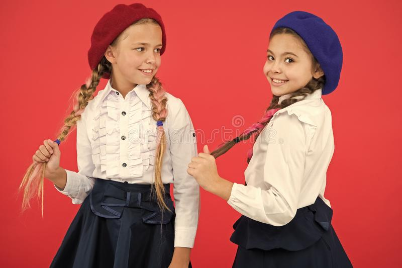 Best friends. Little girls with braids ready for school. School fashion concept. Fancy style. School friendship royalty free stock photo