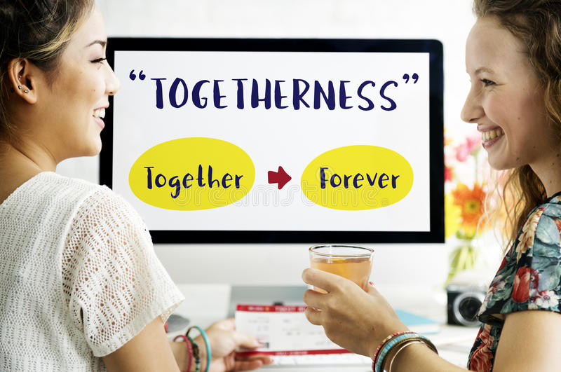 Best Friends Relationships Connecting Concept. Two friends is smiling at each other with computer screen background royalty free stock photography