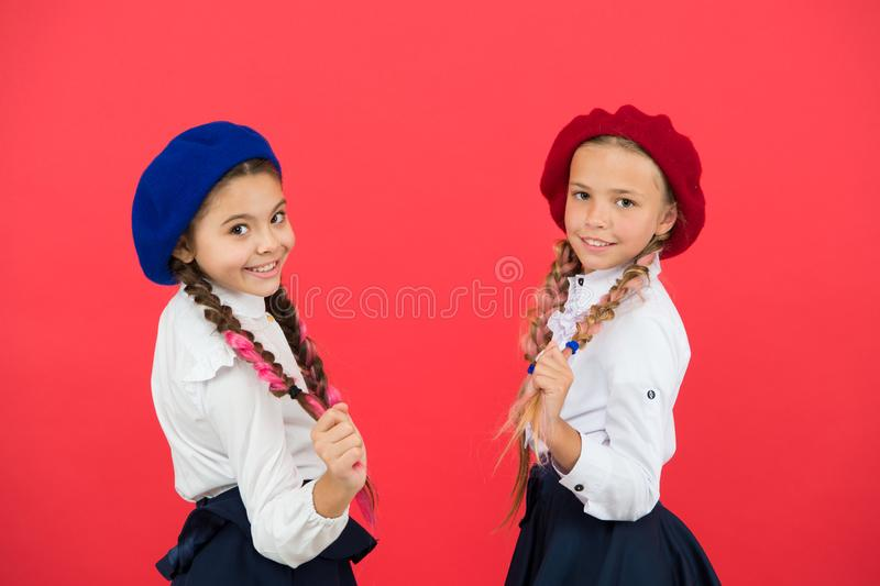 Best friends. Schoolgirls wear formal school uniform. Children beautiful girls long braided hair. Little girls with royalty free stock images