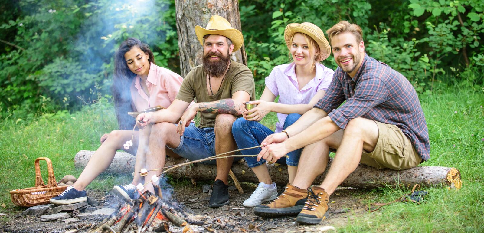 Best friends spend leisure weekend hike barbecue forest nature background. Friends enjoy weekend barbecue in forest royalty free stock image