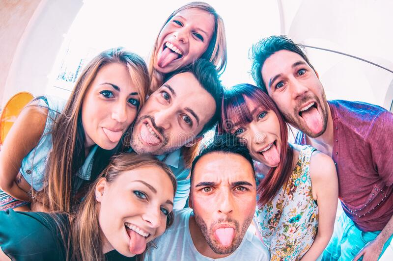 Best friends taking crazy selfie at city tour trip - Happy friendship with millennial students having fun together - Everyday life royalty free stock images