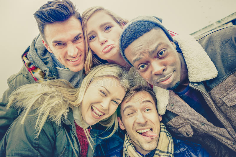 Best friends taking selfie outdoor on autumn winter clothes royalty free stock photos