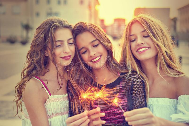 Best friends teen girls with sparklers royalty free stock images