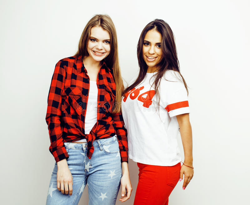 Best friends teenage girls together having fun, posing emotional on white background, besties happy smiling, lifestyle. People concept, blond and brunette multi stock photos