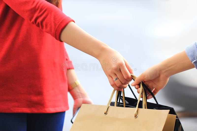 Best Friends,Two teen girls hand holding shopping bags with standing at the department store.  royalty free stock photography
