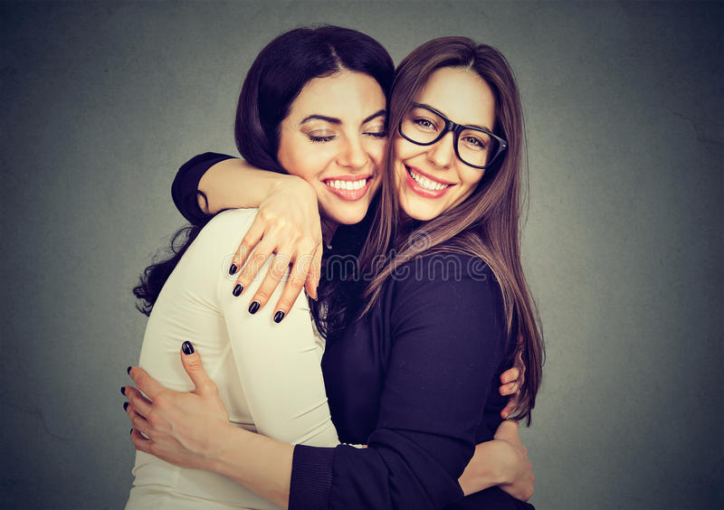Best friends two women hugging each other stock photography