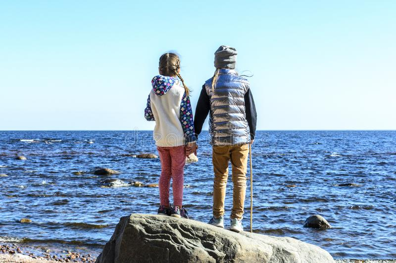Best friends in the world, closeness and feelings are bound by holding hands and looking into the distant distance stock image