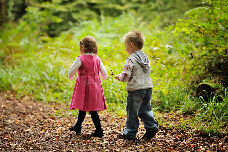 Best Friends. A young girl and boy in the park royalty free stock image