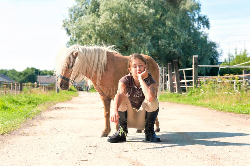 Best friends. Young teenage girl with little shetland pony. royalty free stock images