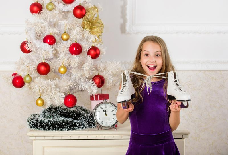 Best gift ever. Happy new year concept. Dreams come true. Got gift exactly she wanted. Figure skating concept. Kid near. Christmas tree hold skates gift. Little stock photos