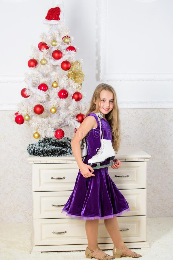 Best gift ever. Happy new year concept. Got gift exactly she wanted. Figure skating concept. Dreams come true. Kid near. Christmas tree hold skates gift. Little stock images