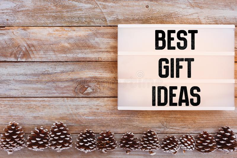 Best Gift Ideas text in lightbox on winter table stock photo