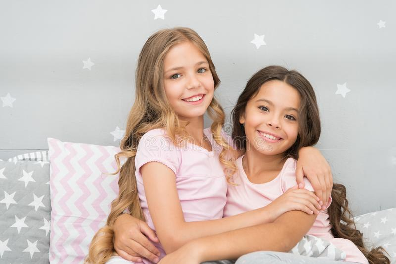 Best girls sleepover party ideas. Soulmates girls having fun sleepover party. Childhood friendship concept. Girls happy royalty free stock photography