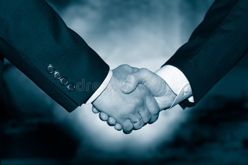Best handshake. Business handshake over abstract blue background stock images
