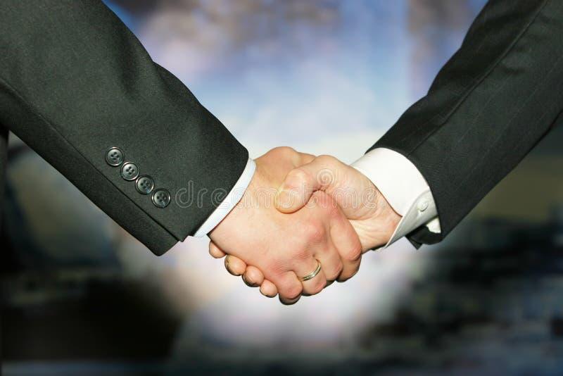 Best handshake. Business handshake over abstract blue background stock photo