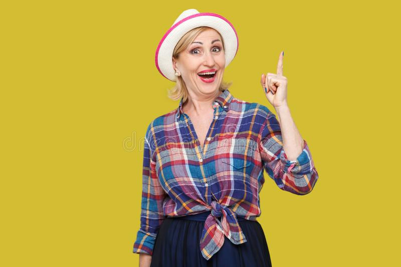 The best idea. Portrait of excited happy modern stylish mature woman in casual style with hat standing, looking at camera with royalty free stock images