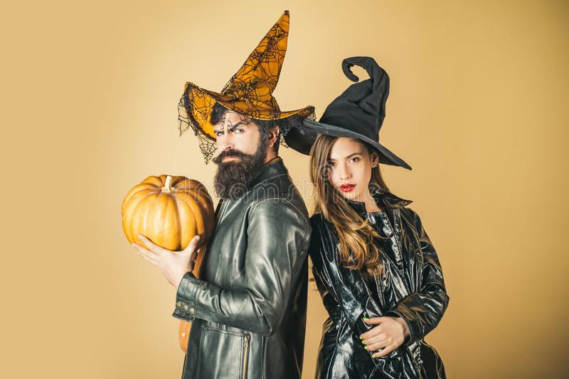 Best ideas for Halloween. Couple posing with Pumpkin. Fashion Glamour Halloween. Portrait of happy young couple in royalty free stock photo
