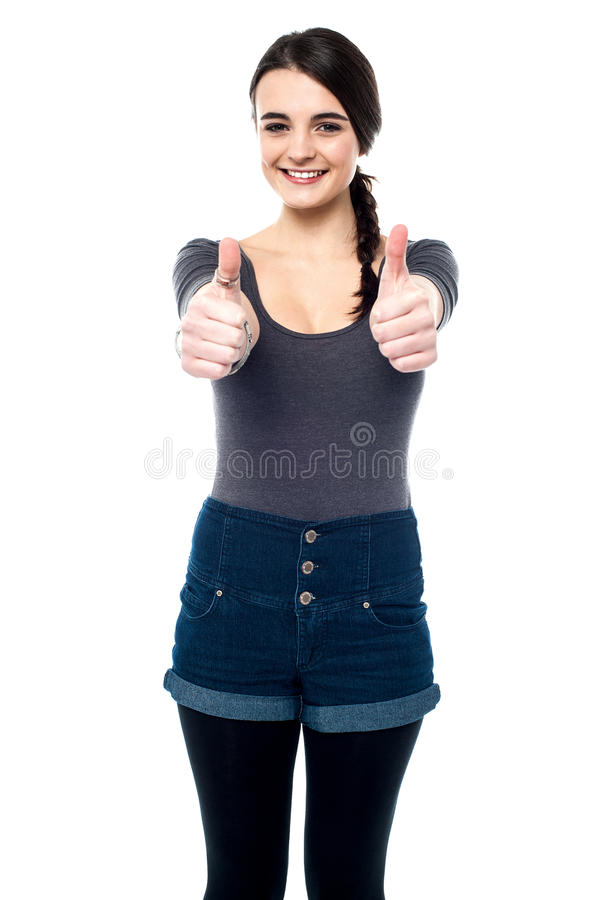 Best of luck my friends. Teen girl making thumbs up gesture by two hands royalty free stock photo