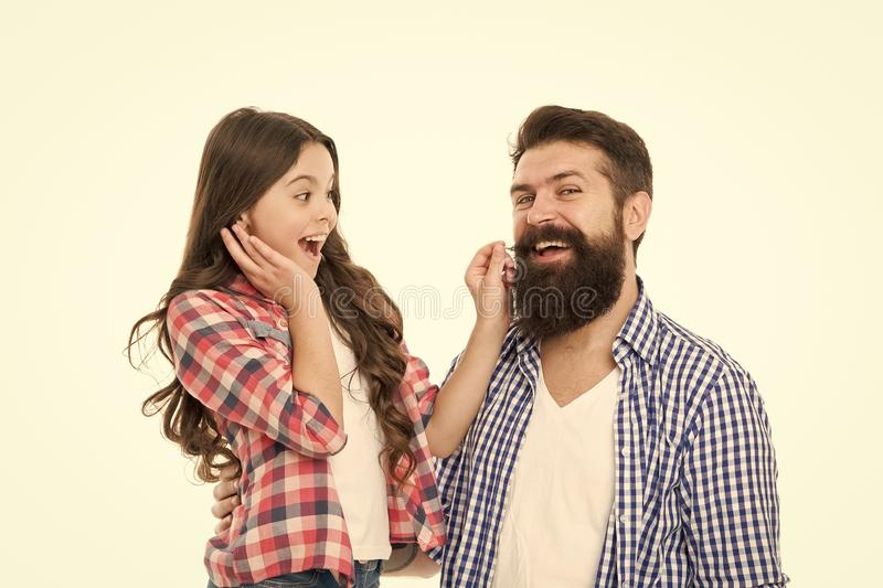 Only the best man can grow a beard. Little daughter touching beard of her father. Bearded man with long beard hair and stock images