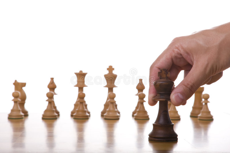 The best move. The king piece of a chess table ready for it's move (selective focus stock photography