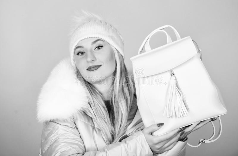 Best offer. girl in puffed coat. faux fur fashion. warm winter clothing. shopping. happy winter holidays. flu and cold. Season. Leather bag fashion. woman in stock photo