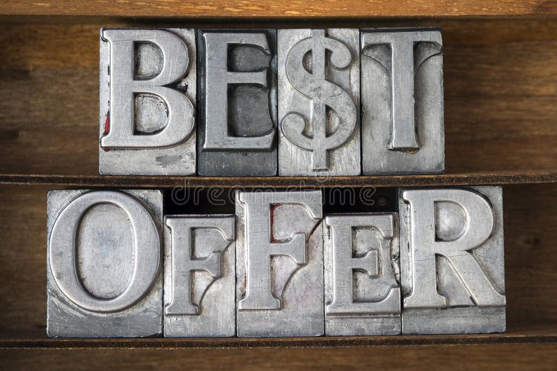 Best offer. Phrase with dollar sign made from metallic letterpress type on wooden tray royalty free stock photography