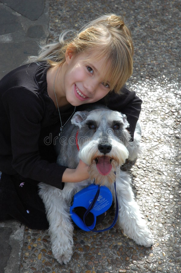Best pals. Girl hugs her dog stock photo