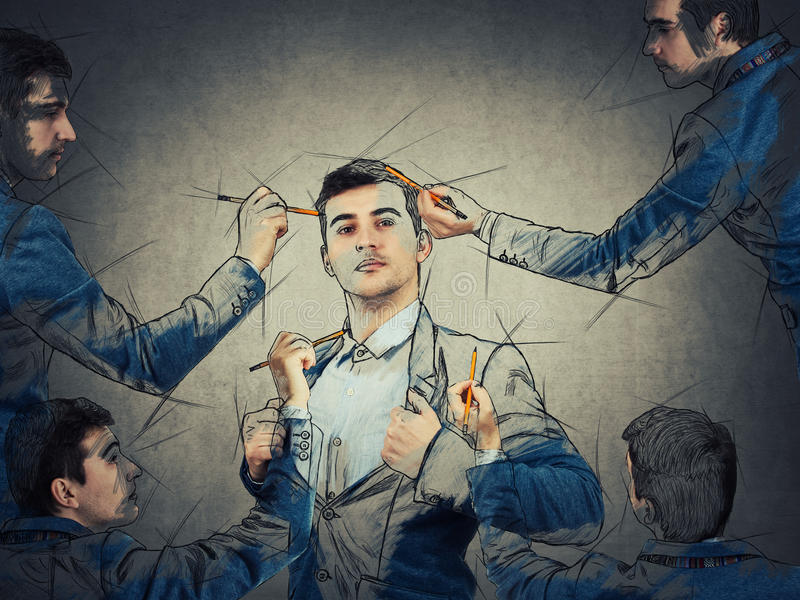 The best part of you. Young businessman in different poses draw himself using a magic pencil. Mannequin idea concept, create new identity, the best model of you royalty free stock images