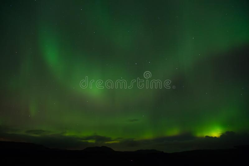 Best place see aurora borealis. Nature miracles. Aurora dark sky. Amazing nature phenomena. When is best time to see. Northern lights. Place to see northern royalty free stock photos