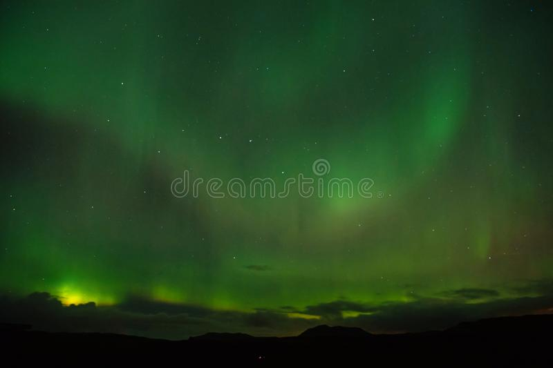 Best place see aurora borealis. Nature miracles. Aurora dark sky. Amazing nature phenomena. When is best time to see. Northern lights. Place to see northern stock photography