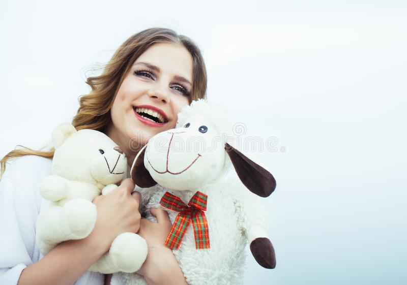 Best present from him. Happy woman hold toys. Young woman smile with soft toys. Beauty girl with makeup on smiling face stock photo