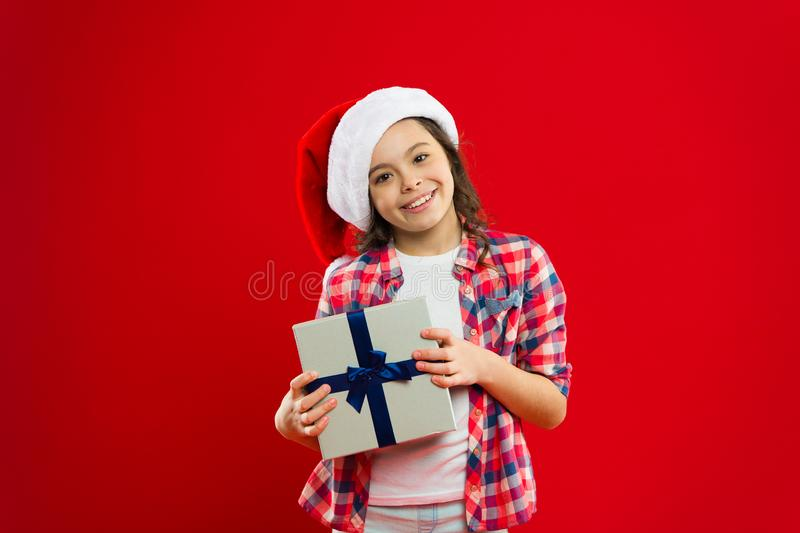 Best present. Little girl child in santa red hat. Christmas shopping. Present for Xmas. Childhood. I cant believe in it. New year party. Santa claus kid. Happy stock image