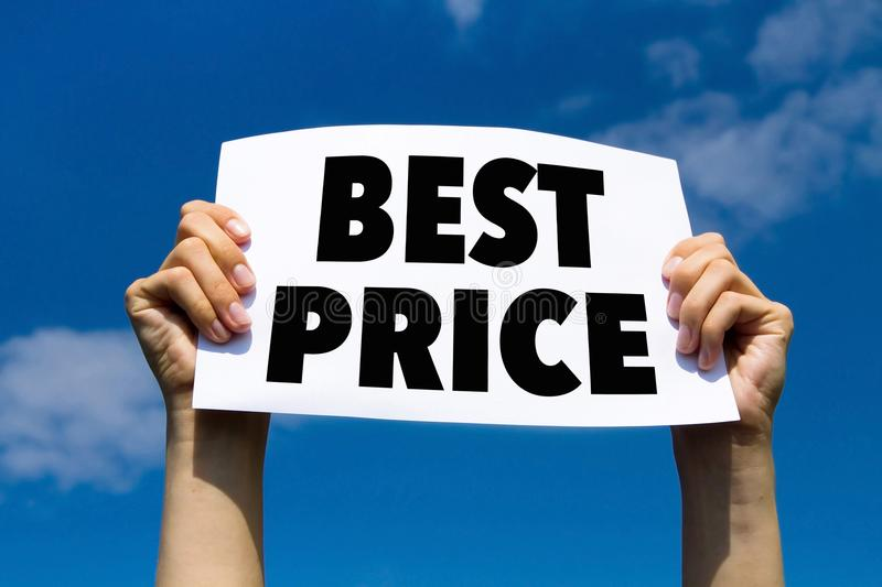 Best price, concept, hands holding paper sign. Best price, promotion, value deal, hands holding paper sign on blue sky background royalty free stock photo