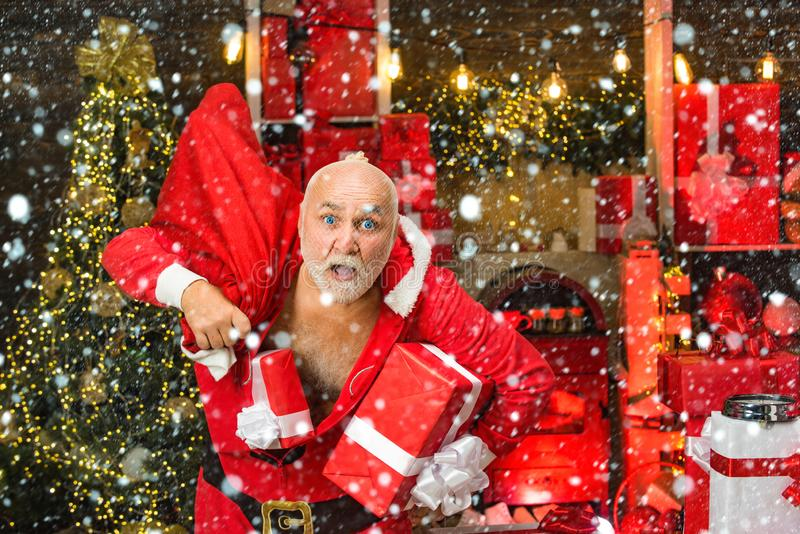 Best prices for winter gifts. Seasonal offer. Christmas sale. Holiday crime scene. Bearded bad Santa Claus and many royalty free stock image