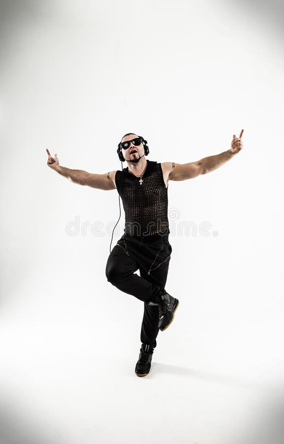 Best rapper dancing break dance .photo on a white background. Rapper with headphones takes breakdancing. photo on a white background and has an empty space for stock image