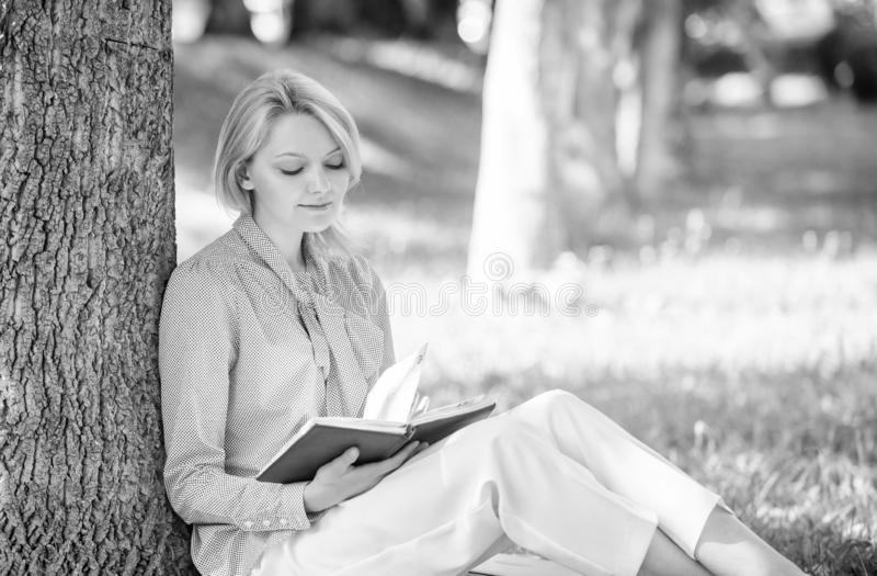 Best self help books for women. Books every girl should read. Girl concentrated sit park lean tree trunk read book stock images