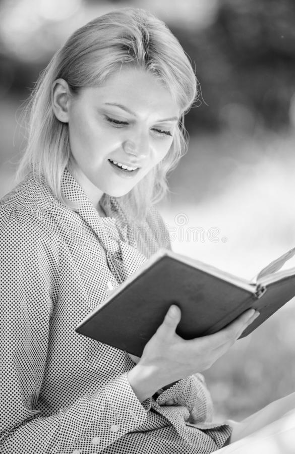 Best self help books for women. Books every girl should read. Girl interested sit park read book nature background stock photo