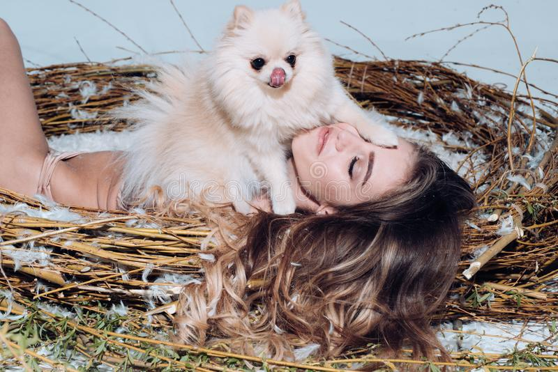 Best softener ever. Fashion model. Attractive woman enjoying softness of feather in giant nest. Pretty easter bird royalty free stock photo