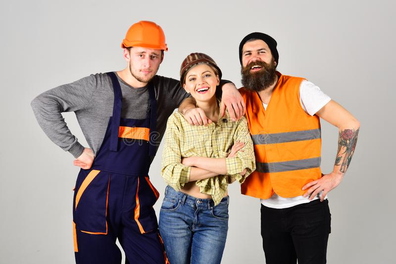 The best team ever. Men and woman builders in workwear. Construction technicians. Construction workers team stock image