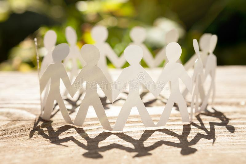 The best teamwork. Concept of business teamwork with paper people chain