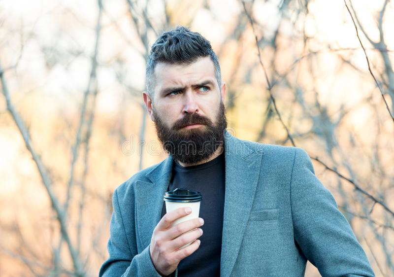 The best time of day to drink coffee. Lawyer hold cup of hot drink outdoor. Bearded man enjoy short drink break. Tasty stock images