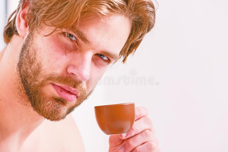 Best time to have your cup of coffee. Guy attractive appearance man enjoy hot fresh brewed coffee close up. First sip royalty free stock photos